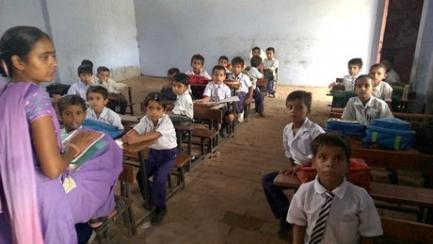Une classe à la Kamal Public Junior High School